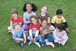 Multiracial group of children smiling,