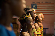 Young members of the Liberian Dance Troupe (LDT) sing the national anthem of Liberian during a performance at the Buduburam refugee settlement, roughly 20 km west of Accra, Ghana's capital, on Saturday April 14, 2007. One of the main goals of the LDT is to teach young refugee children, many of which have never seen Liberia, about their country's music, dance and culture. The Buduburam refugee settlement is still home over 30,000 Liberians, most of which have mixed feelings about returning to Liberia.
