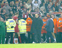 LIVERPOOL, ENGLAND - Tuesday, March 19, 2002: Liverpool's manager Gerard Houllier celebrates his side's 2-0 victory over AS Roma during the UEFA Champions League Group B match at Anfield. (Pic by David Rawcliffe/Propaganda)