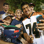 Miles Thompson #74 of the Rochester Rattlers takes a selfie with some young fans following the game at Harvard Stadium on August 9, 2014 in Boston, Massachusetts. (Photo by Elan Kawesch)