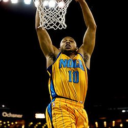 Jan 25, 2013; New Orleans, LA, USA; New Orleans Hornets shooting guard Eric Gordon (10) dunks against the Houston Rockets during  the first quarter of a game at the New Orleans Arena. Mandatory Credit: Derick E. Hingle-USA TODAY Sports
