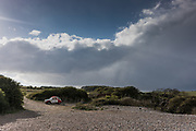 East Sussex, England, UK, May 4 2019 - A Citroen 2CV car near the coastguard cottages and the Seven Sisters cliffs, on the Seaford Head side.
