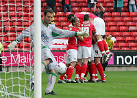 Photo: Paul Thomas.<br /> Barnsley v Southampton. Coca Cola Championship. 19/08/2006.<br /> <br /> Marc Richards and Barnsley celebrate his goal (R) while Southampton keeper Kelvin Davis kicks the ball out off his net.