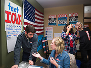 19 DECEMBER 2019 - URBANDALE, IOWA: MITCH SMITH, left, a member of Sen Cory Booker's campaign staff, talks to DAWN HALSTEAD, a volunteer, about the campaign phone bank at Sen. Cory Booker's campaign headquarters in Urbandale, a suburb of Des Moines. Sen. Booker, who did not qualify for the December 19 debate in Los Angeles, campaigned in the Des Moines area Thursday and visited the phone bank at his Iowa campaign headquarters. Iowa traditionally holds the first event of the presidential election cycle. The Iowa caucuses at Feb. 3, 2020.               PHOTO BY JACK KURTZ