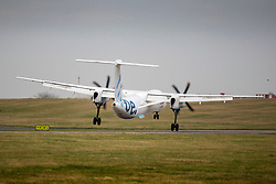 © Licensed to London News Pictures. 06/01/2020. Leeds UK. A Flybe aircraft arriving from Belfast struggles to land in strong winds at Leeds Bradford airport as the Met Office issues a weather warning for the north of the UK. Photo credit: Andrew McCaren/LNP