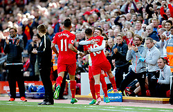 Philippe Coutinho of Liverpool celebrates with team mate Alberto Moreno - Mandatory by-line: Matt McNulty/JMP - 23/04/2017 - FOOTBALL - Anfield - Liverpool, England - Liverpool v Crystal Palace - Premier League