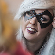 Britni McNeil talks to friends dressed as Blackcat Sunday December 7, 2014 during Aniwave 2014 at the Wilmington Convention Center in Wilmington, N.C. (Jason A. Frizzelle)
