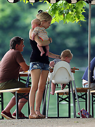 Peaches Geldof and husband Thomas Cohen enjoying an afternoon at the park with their two sons Astala and Phaedra. Peaches was spotted doing the natural thing breast feeding her youngest son Phaedra, and still managed to help her eldest son Astala with his bottle of juice. After a spot of lunch the happy mum grabbed a very large ice-cream from an ice-cream van which she sharred with her family on the way home... UK. <br />BYLINE MUST READ : JAMESY/GOTCHA IMAGES<br /><br />Copyright by © Gotcha Images Ltd. All rights reserved.<br />Usage of this image is conditional upon the acceptance <br />of Gotcha Images Ltd, terms and conditions available at<br />www.gotchaimages.com