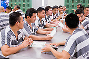 "06 NOVEMBER 2006 - PHOENIX, AZ:  Maricopa County prisoners sit in the dayroom at the jail and wait to return to their tents after English class. Maricopa County Sheriff Joe Arpaio is offering intensive two week English classes in the Maricopa County Jails so county prisoners can communicate with Detention Officers. The classes teach ""jail English"" so inmates can report medical problems, request their lawyers, request bedding etc. There are more than 1,000 illegal immigrants in the county jail system. In 2011, the US Department of Justice issued a report highly critical of the Maricopa County Sheriff's Department and the jails. The DOJ said the Sheriff's Dept. engages in widespread discrimination against Latinos during traffic stops and immigration enforcement, violates the rights of Spanish speaking prisoners in the jails and retaliates against the Sheriff's political opponents.      PHOTO BY JACK KURTZ"