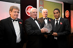 CARDIFF, WALES - Wednesday, November 11, 2009: Wales' Ashley Williams is presented with the Welsh Club Player of the Year trophy by SA Brains' Chairman John Rhys, President Phil Pritchard and General Secretary David Collins during the Football Association of Wales Player of the Year Awards hosted by Brains SA at the Cardiff City Stadium. (Pic by David Rawcliffe/Propaganda)
