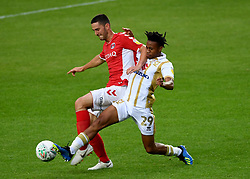 Milton Keynes Dons' David Kasumu (right) and Charlton Athletic's Ryan Blumberg (left) battle for the ball