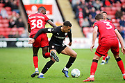Barnsley forward Jacob Brown (33) and Walsall FC forward Corey Blackett-Taylor (38) during the EFL Sky Bet League 1 match between Walsall and Barnsley at the Banks's Stadium, Walsall, England on 23 March 2019.
