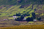 Homes nestling at the foot of the Twelve Bens mountain range in Connemara National Park, County Galway, Ireland