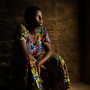 "Ayisa (approximately 16), pictured in the Upper West region of Ghana on 28 May 2014, completed Form 3 at school but then dropped out after she fell pregnant. The father of her child is a motorcycle mechanic, and she says they both want to get married. When asked about her plans for the future she replied, ""My plan is to go to school again."" She says wants to be a nurse. Ayisa says she learned about birth control in school, but didn't think pregnancy would happen to her."