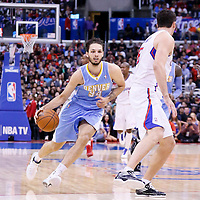 15 April 2014: Denver Nuggets guard Evan Fournier (94) drives past Los Angeles Clippers forward Hedo Turkoglu (8) during the Los Angeles Clippers 117-105 victory over the Denver Nuggets at the Staples Center, Los Angeles, California, USA.