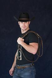 portrait of a cowboy holding reins