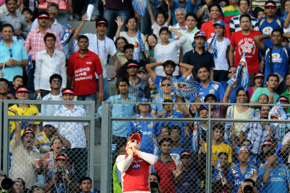 Crowd reacts as David Miller of Kings XI Punjab finishes  a catch to get James Franklin of Mumbai Indians out during match 28 of the Indian Premier League ( IPL) 2012  between The Mumbai Indians and the Kings X1 Punjab held at the Wankhede Stadium in Mumbai on the 22nd April 2012..Photo by Pal Pillai/IPL/SPORTZPICS.