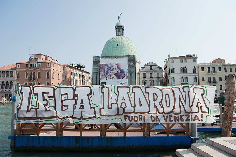 VENICE, ITALY - SEPTEMBER 17: a sign against the Northern Legue (Lega Nord) is seen on the Canal Grande ahead of tomorrow's Northern League rally on September 17, 2011 in Venice, Italy. Clashes broke out between police and protesters after a coalition opposed to the Northern League demonstrated against the party's planned rally to be held at the Riva Sette Martiri in Venice.