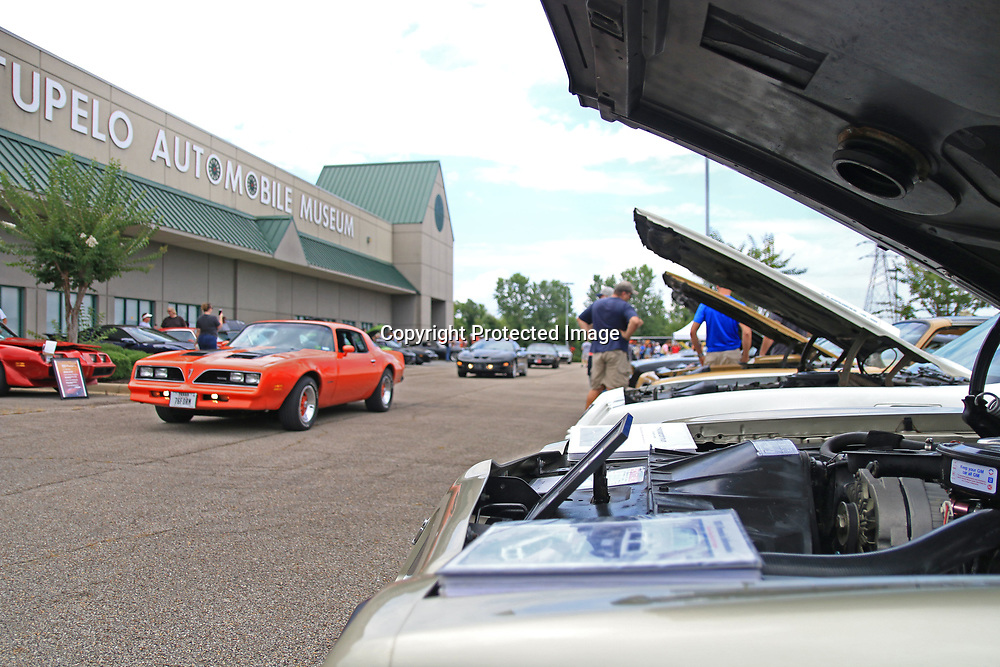 Trans Ams and other muscle cars pour into the back parking lot at the Tupelo Automobile Museum during The Bandit Run celebrating the 40th anniversary of the movie 'Smokie and the Bandit'.