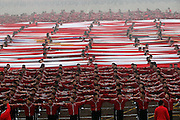 ZHENGZHOU, CHINA - NOVEMBER 10: (CHINA OUT) <br /> <br /> Is this China's answer to winning the World Cup? Chinese city establishes a 'Shaolin Soccer' academy that incorporates kung fu into its football regime<br /> <br /> <br /> Is this China's answer to winning the World Cup? Chinese city establishes a 'Shaolin Soccer' academy that incorporates kung fu into its football regime<br /> <br />     35,000 students currently train at the Shaolin Tagou Martial Arts School<br />     100 male and female students chosen from those are in the new academy<br />     The camp is based in Dengfeng, China, and will mix kung fu and football<br /> <br /> By Chloe Lyme For Mailonline<br /> <br /> Published: 18:29, 12 November 2015 | Updated: 18:40, 12 November 2015<br /> <br /> 7<br /> shares<br /> <br /> 7<br /> <br /> View comments<br /> <br /> One hundred young footballers have taken training to new extremes at the historic Shaolin Tagou Martial Arts School in east China's Dengfeng city, Henan Province.<br /> <br /> The coaching base opened a new football academy on November 10, which will combine Shaolin kung fu with football, 35,000 students currently train at the school but only 100 of those will be chosen to enter the academy. It's intended to become China's way of improving its footballers. The are two classes, split into male and female, with 50 pupils in each. All of the students are aged 10 to 12.<br /> <br /> Children who attend the football training have been specifically chosen from the martial arts school, so they are already young kung fu masters in the making.<br /> <br /> They know every aspect of the art, which consists of stamina, flexibility, balance, meditation and combat skills.<br /> The academy is equipped with three senior football coaches responsible for training the young athletes and junior coaches.<br /> <br /> Training is motivated by the 'great three-five-eight battle plan.'<br /> <br /> They expect to see massive improvements in three years, success 