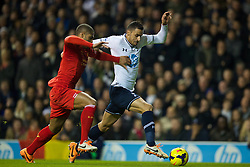 LONDON, ENGLAND - Sunday, December 15, 2013: Liverpool's Glen Johnson in action against Tottenham Hotspur's Nacer Chadli during the Premiership match at White Hart Lane. (Pic by David Rawcliffe/Propaganda)