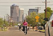 South Tucson resident Alba Davis cycles through to work on a Sunday morning in Tucson, Arizona, USA.