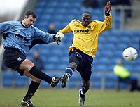 Photo: Scott Heavey.<br />Oxford United v Huddersfeild Town. Nationide Division Three. 06/03/2004.<br />Huddrsfield's keeper, Paul Rachubka clears the ball from Mark Rawle