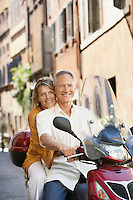 Middle-aged couple on scooter on street in Rome Italy portrait