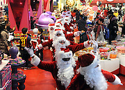 Santas bunny hop through legendary FAO Schwarz as they deliver holiday PEEPS and spread cheer, Wednesday, Dec. 4, 2013, in New York. (Photo by Diane Bondareff/Invision for PEEPS/AP Images)