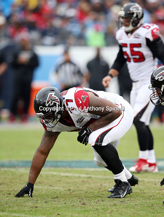 Atlanta Falcons defensive end Ra'Shede Hageman (77) gets set during the 2015 week 7 regular season NFL football game against the Tennessee Titans on Sunday, Oct. 25, 2015 in Nashville, Tenn. The Falcons won the game 10-7. (©Paul Anthony Spinelli)
