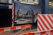 Construction hoarding and London cityscape showing the capital at The Pinnacle project on Bishopsgate in the City of London. Construction work has been suspended again on the Pinnacle in the City of London. Contractor Brookfield is understood to have been told to stop work following more funding concerns over the Square Mile's tallest tower. Brookfield restarted work last September after developer Arab Investments put together a new finance package. But a lack of a pre-let tenant has now caused further delays on site leaving Byrne Bros concrete cores standing idle. The Bishopsgate Tower, informally referred to as The Pinnacle, was to be a 288 m (945 ft), 64-storey skyscraper in the centre of London's main financial district.