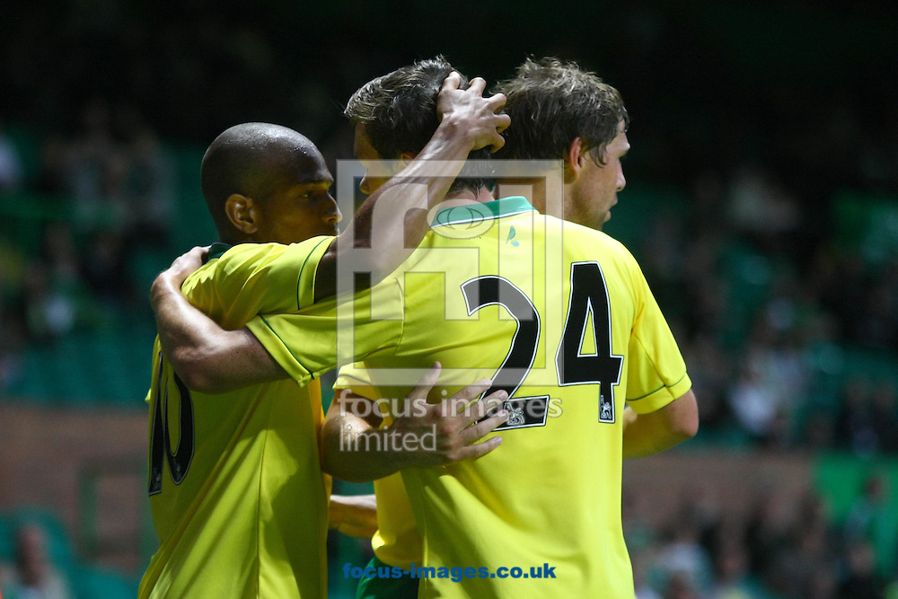 Picture by Paul Chesterton/Focus Images Ltd +44 7904 640267.24/07/2012.Grant Holt of Norwich opens the scoring and celebrates during the Friendly match at Celtic Park, Glasgow.