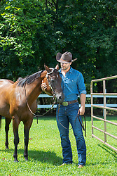 cowboy with an affectionate horse on a ranch