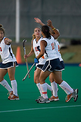 Virginia Cavaliers M/B Boyd Vicars (15) celebrates with Virginia Cavaliers B Inge Kaars Sijpesteijn (11) after Sijpestejn scored on a penalty shot.  The Virginia Cavaliers field hockey team faced the Radford Highlanders at the University Hall Turf Field in Charlottesville, VA on October 10, 2007.