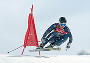 2/14/06 -- The 2006 Torino Winter Olympics -- Sestriere , Italy. -- Alpine skiing - Men's Downhill Combined -- .USA Team skier Steven Nyman speeds past a gate during the downhill portion of the Men's Combined event in Sestriere Borgata, Italy...Photo by Scott Sady, USA TODAY staff.