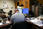 At his desk at the Main Fire Station in Manchester, NH, Wednesday, Aug. 10, 2016, EMS officer/firefighter paramedic Chris Hickey works at his computer logging in the past Friday's twenty-three walk-in addicts . <br /> To help combat Manchester New Hampshire's huge drug problem, anyone can walk into the main fire station seeking help, they'll get connected with a drug counselor and services. Something like 230 people have shown up in the first couple months and it's quickly spawning copy-cat programs.  <br />    (Cheryl Senter for The Wall Street Journal)