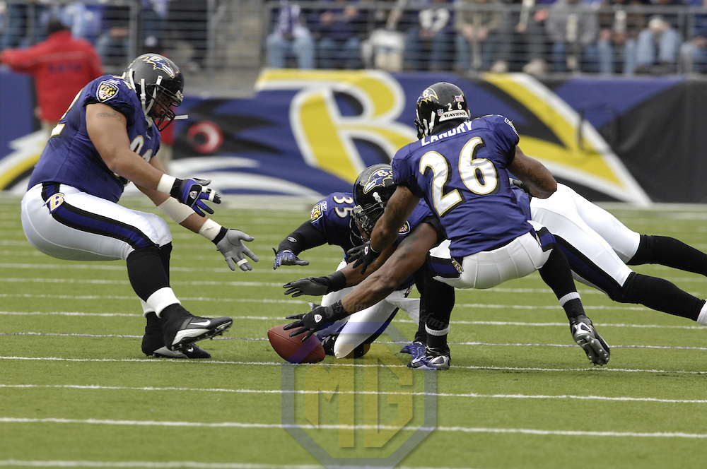 18 November 2007:  Baltimore Ravens linebacker Ray Lewis (52) recovers a fumble by Cleveland Browns wide receiver Braylon Edwards as safety Dawan Landry (26), defensive tackle Haloti Ngata (92) and cornerback Corey Ivy (35) all prepare to pounce on the loose ball in the 1st quarter on November 18, 2007 at M&T Bank Stadium in Baltimore, Maryland. The Ravens were sent to their 4th consecutive loss with a 33-30 overtime time win by the Browns.