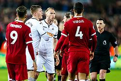 Mike van der Hoorn of Swansea City and Emre Can of Liverpool argue after Swansea City win 1-0 - Rogan/JMP - 22/01/2018 - FOOTBALL - Liberty Stadium - Swansea, Wales - Swansea City v Liverpool - Premier League.