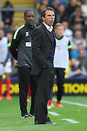 Picture by David Horn/Focus Images Ltd +44 7545 970036<br /> 14/09/2013<br /> Gianfranco Zola Manager of Watford (fornt) and Chris Powell Manager of Charlton Athletic look on during the Sky Bet Championship match at Vicarage Road, Watford.