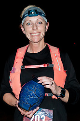 January 19, 2019 - Southern Pines, North Carolina, US - Jan. 19, 2019 - Southern Pines N.C., USA - Amanda Barnett, Lillington, North Carolina, wins the women's division at the 10th Annual Weymouth Woods 100km ultra marathon at the Weymouth Woods Nature Preserve. Runners needed to complete 14 laps of the 4.47 mile course for 62.58 miles in under the 20-hour time allotment. (Credit Image: © Timothy L. Hale/ZUMA Wire)