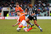 Luton Town's Stephen O'Donnell is fouled by Plymouth Argyle's Reuben Reid during the Sky Bet League 2 match between Plymouth Argyle and Luton Town at Home Park, Plymouth, England on 19 March 2016. Photo by Graham Hunt.