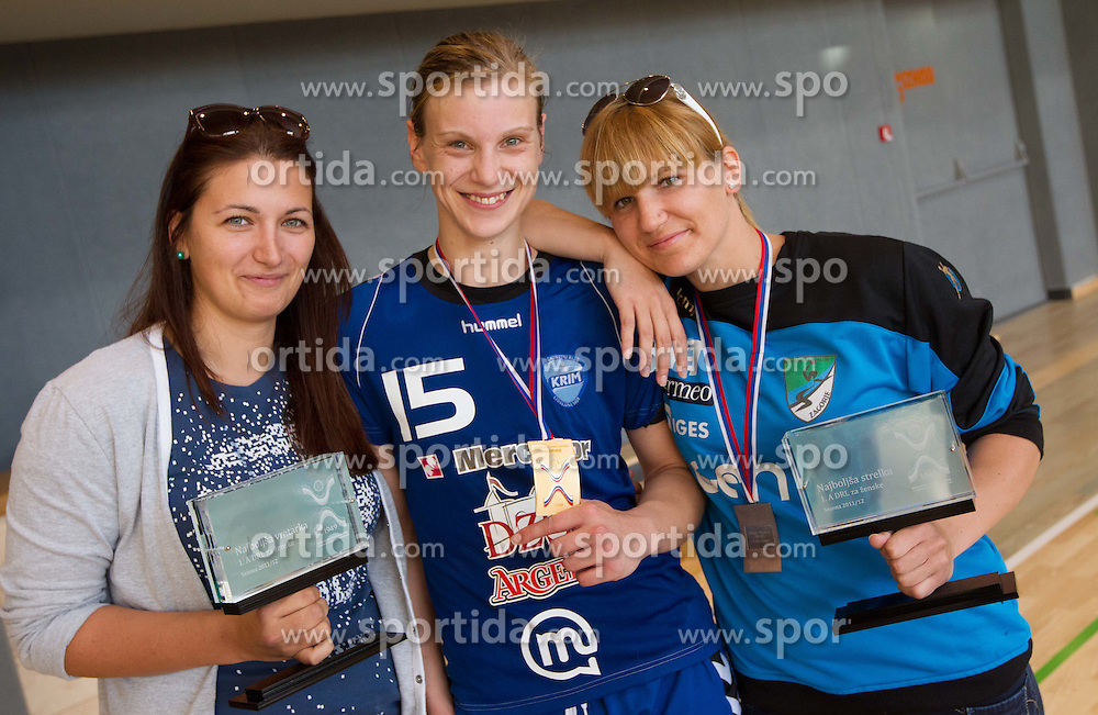 Branka Zec, Barbara Varlec Lazovic and Neli Irman celebrate after the last game of 1st A Slovenian Women Handball League season 2011/12 between ZRK Krka and RK Krim Mercator, on May 8, 2012 in Stopice at Novo mesto, Slovenia. RK Krim Mercator became Slovenian National Champion, GEN-I Zagorje placed second and ZRK Krka placed third. (Photo by Vid Ponikvar / Sportida.com)