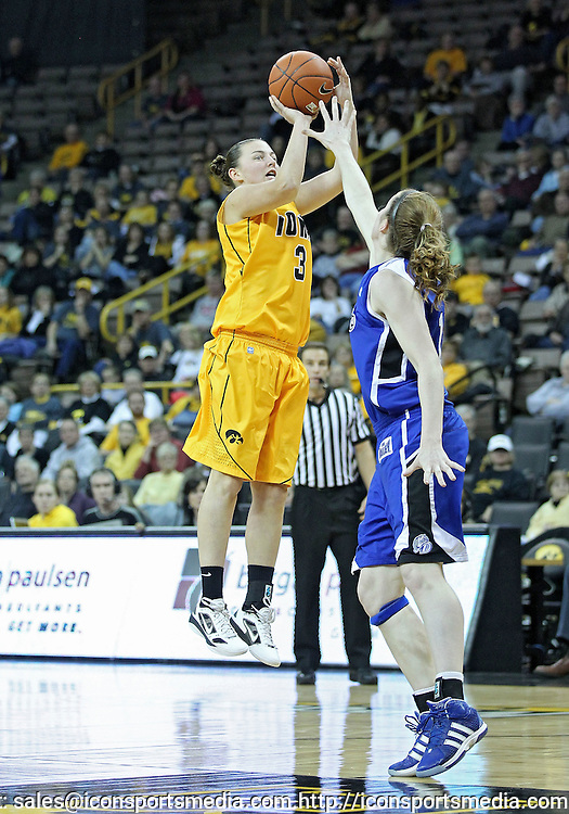 December 20, 2011: Iowa Hawkeyes forward Kalli Hansen (3) puts up a shot over Drake Bulldogs guard Carly Grenfell (1) during the NCAA women's basketball game between the Drake Bulldogs and the Iowa Hawkeyes at Carver-Hawkeye Arena in Iowa City, Iowa on Tuesday, December 20, 2011. Iowa defeated Drake 71-46.