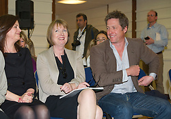 © Licensed to London News Pictures. 17/05/2012. London, UK. Labour MP Harriet Harman (centre) and Actor Hugh Grant (right) attend a rally for media reform organised by Hacked Off and the Co-ordinating Centre for Media Reform at Central Hall, Westminster, London on May 17, 2012. Photo credit : Ben Cawthra/LNP