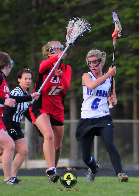 5/11/09 -- TOPSHAM, Maine.  Mt Ararat's Meghan Dano drives through Cony's Captain Holly Parker on the way to the net on Monday evening to score one of her several goals en route to a strong victory. At the half the score was 7-3 in favor of Mt Ararat. Between Meghan and her sister, Whitney, they had scored five of the seven Eagle goals and had contributed with an assist each as well. Contributing to the win, Evelyn Dickinson was a stone wall in the net  Mt. Ararat went on to win.  Photo by Roger S. Duncan.