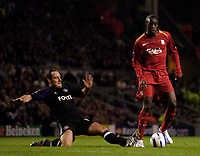 Photo: Jed Wee.<br />Liverpool v Anderlecht. UEFA Champions League.<br />01/11/2005.<br /><br />Liverpool's Momo Sissoko (R) is tackled by Anderlecht's Yves Vanderhaeghe.