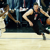 LOS ANGELES, CA - APR 26: Danilo Gallinari (8) of the LA Clippers drives past Draymond Green (23) of the Golden State Warriors during Game 6 of the Western Conference First Round on April 26, 2019 at the Staples Center, in Los Angeles, California.