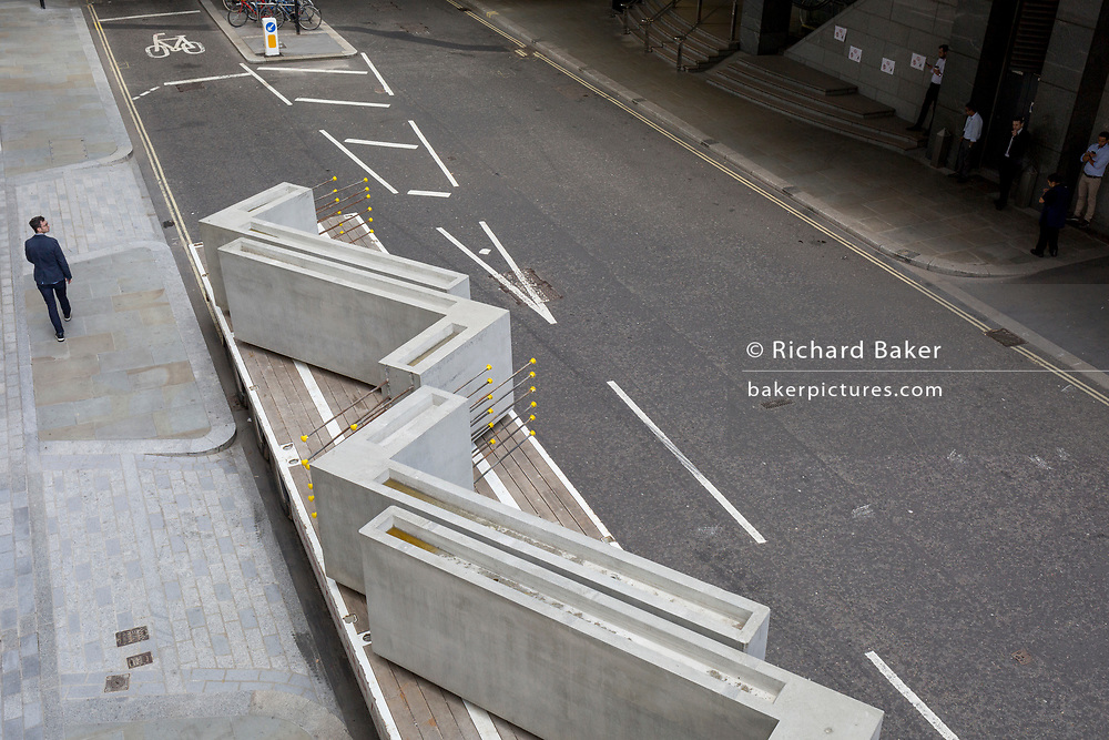 Large concrete right-angled blocks awaiting offloading from a lorry in Wood Street in the City of London - the capital's financial district, on 21st August 2018, in London, England.