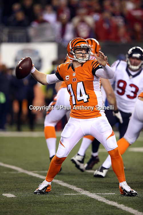 Cincinnati Bengals quarterback Andy Dalton (14) throws for a second quarter first down during the 2015 week 10 regular season NFL football game against the Houston Texans on Monday, Nov. 16, 2015 in Cincinnati. The Texans won the game 10-6. (©Paul Anthony Spinelli)