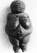 Venus of Willendorf: Stone age oolitic limestone carving.